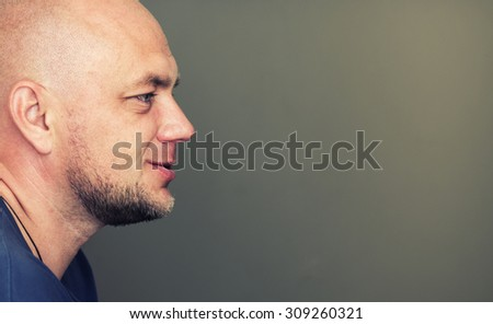 Profile portrait of bald man with copyspace.  - stock photo