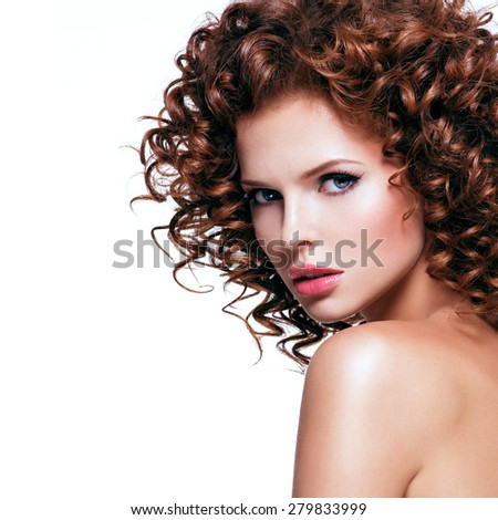 Profile portrait of beautiful young sexy woman with brunette curly hair looking at camera - isolated on white. - stock photo