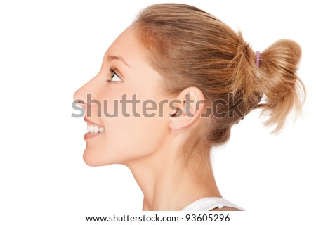 Profile portrait of beautiful young smiling woman isolated on white background - stock photo