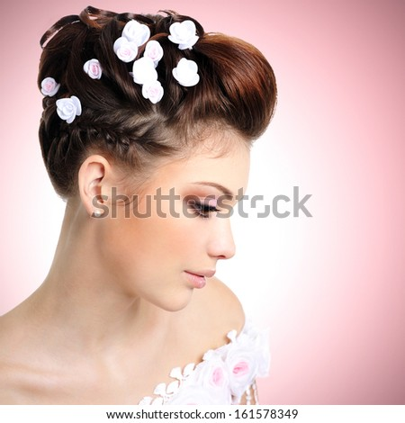 Profile portrait of  bride with beauty make-up and hairstyle - stock photo