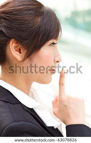 Profile portrait of lady with secret - stock photo