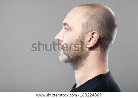 profile portrait of man isolated on gray background with copyspace - stock photo
