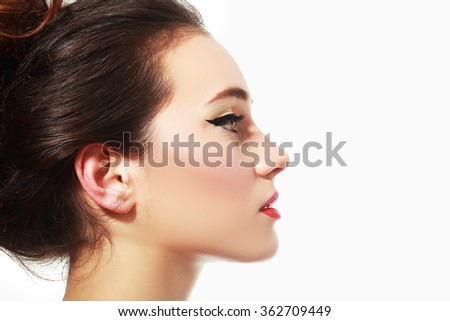 Profile portrait of the beautiful young girl - isolated on white background - stock photo