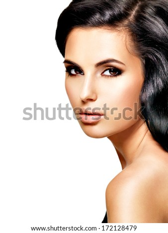 Profile portrait of the beautiful  young woman - posing at studio - stock photo