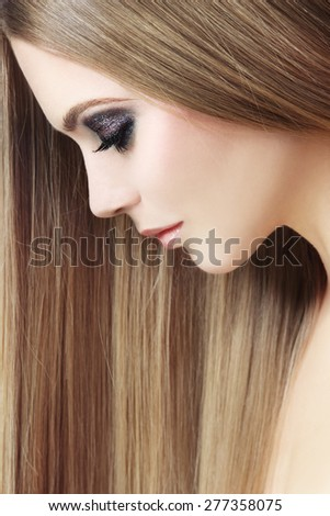 Profile portrait of young beautiful woman with long hair, selective focus - stock photo
