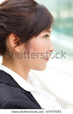 Profile portrait of young confident businesslady