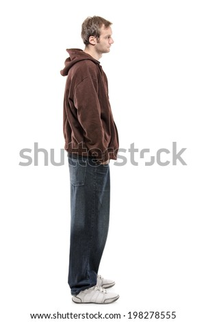 Profile shot of a casual young man isolated on white background - stock photo