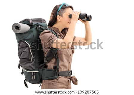 Profile shot of a female hiker looking through binoculars isolated on white background