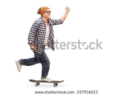 Profile shot of a joyful senior skater riding a skateboard isolated on white background - stock photo