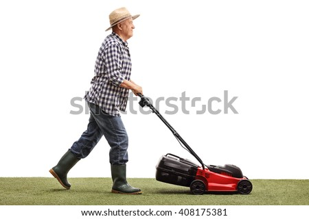 Profile shot of a mature gardener mowing a lawn with a lawnmower isolated on white background - stock photo