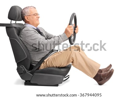Profile shot of a senior gentleman holding a steering wheel and pretending to drive isolated on white background - stock photo