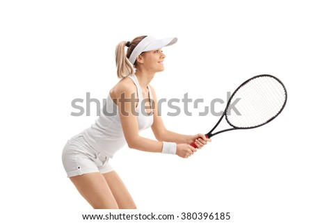 Profile shot of a young blond woman playing tennis isolated on white background - stock photo