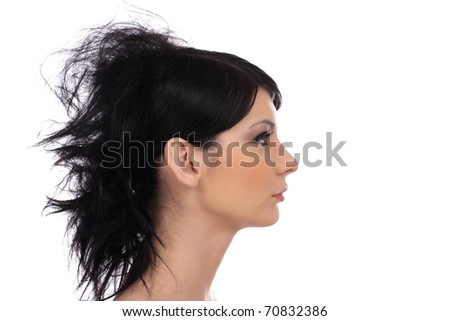 Profile shot of beautiful young woman with elegant hairstyle - stock photo