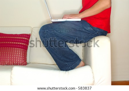 Profile shot of casual guy working on laptop (high key) - stock photo