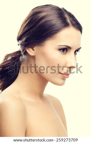 Profile side portrait of young woman - stock photo