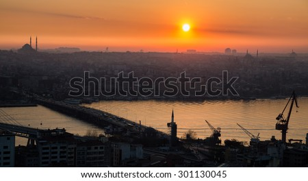 Profile view golden horn in Istanbul at sunset, high contrast with mosque in the skyline - stock photo
