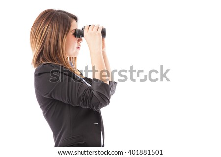 Profile view of a businesswoman looking through binoculars representing a job search. Plenty of copy space