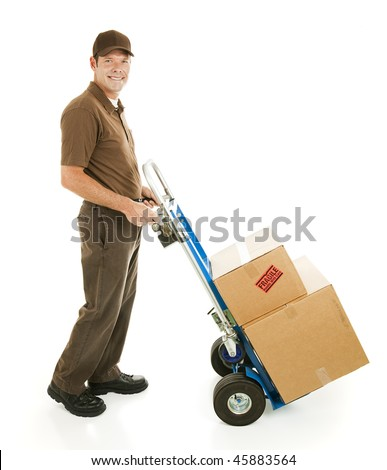 Profile view of a handsome delivery man or mover carrying boxes on a hand cart. - stock photo