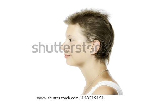 Profile view of a portion of a face of a young pretty girl, isolated on white background