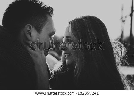 Profile view of an attractive couple - stock photo
