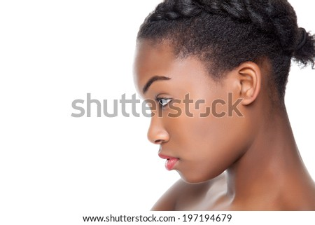 Profile view of an young black beauty - stock photo