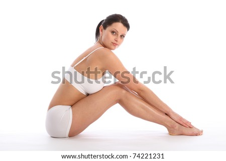 Profile view of beautiful healthy young woman wearing white sports underwear. - stock photo