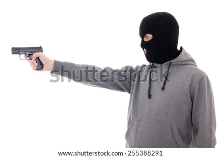 profile view of man in mask aiming with gun isolated on white background - stock photo