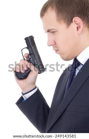 profile view of serious man in business suit with gun isolated on white background - stock photo