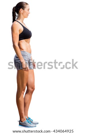 Profile view of sportswoman standing on a white background