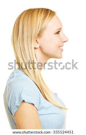Profile view of young blonde happy woman smiling - stock photo