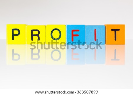 Profit - an inscription from children's wooden blocks - stock photo