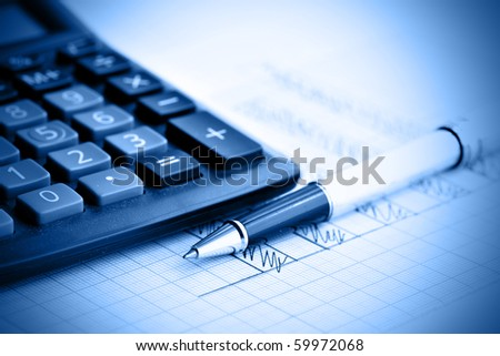 Profit bar chart, pen and calculator. Shallow DOF! Focus on the pen. - stock photo
