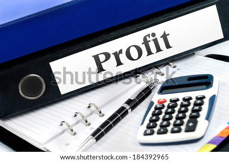 Profit folder with office tools - stock photo