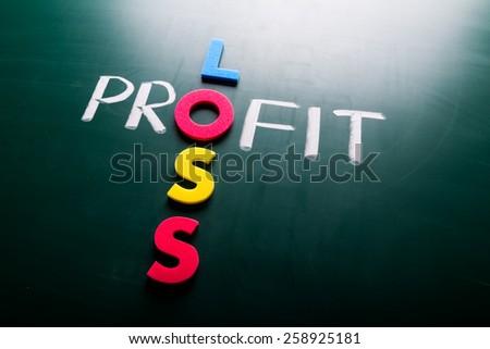 Profit loss business concept, words on blackboard - stock photo