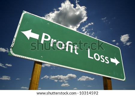 Profit, Loss road sign with dramatic blue sky and clouds.