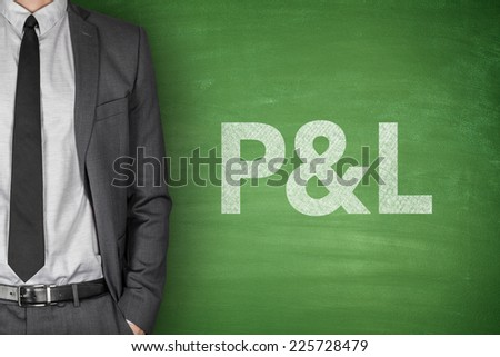 Profit & loss statement on green blackboard with businessman - stock photo
