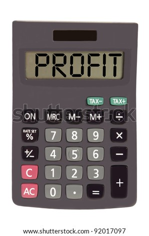 profit on display of an old calculator on white background