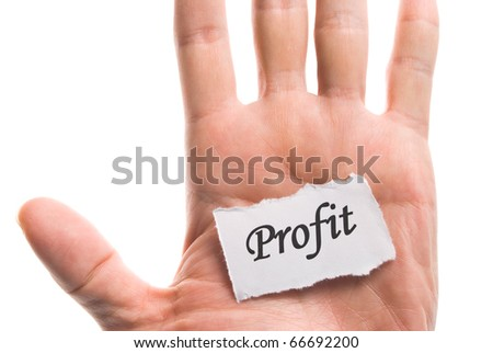Profit word in hand, word on piece tear paper