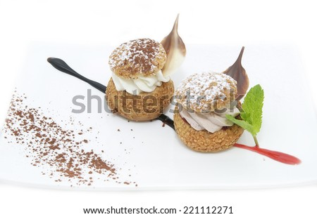 profiteroles with vanilla ice cream decorated with chocolate mint - stock photo