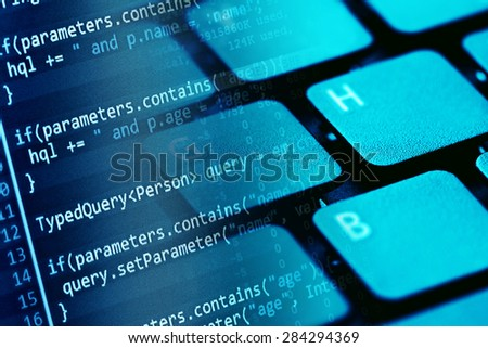 Program code on a monitor and computer keyboard. Small depth of  - stock photo