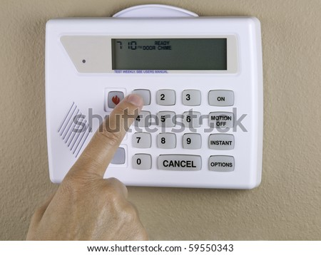 Programing a home security system - stock photo