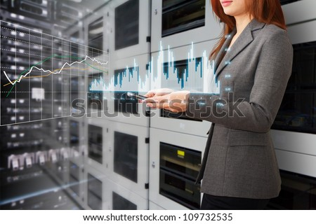 Programmer and graph report to monitor the system in data center room - stock photo