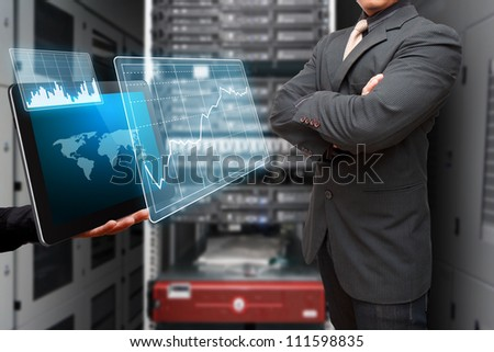 Programmer and graph report to monitor the system in data center room from digital tablet - stock photo