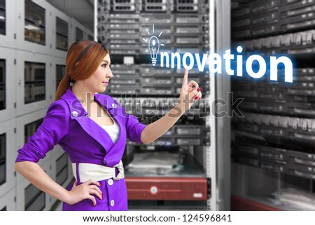 Programmer and innovation word in data center room