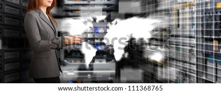 Programmer and world map control in data center room - stock photo