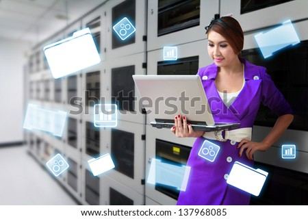 Programmer in data center room - stock photo