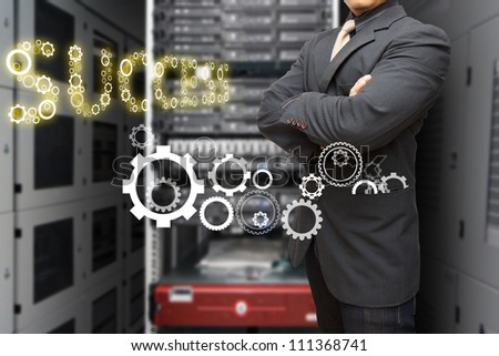 Programmer in data center room and gear to success - stock photo