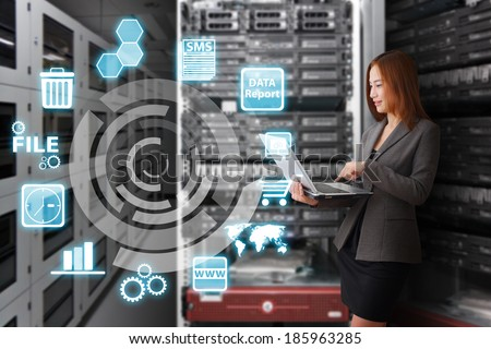 Programmer in data center room and icon control the system  - stock photo