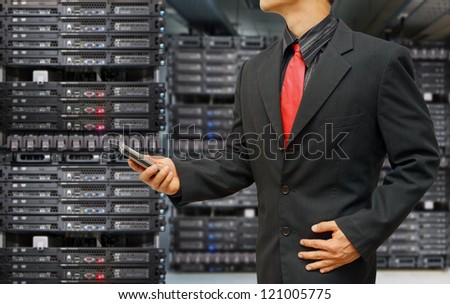 Programmer in data center room and Log in screen activated for security - stock photo