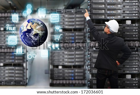 Programmer in data center room : Elements of this image furnished by NASA - stock photo
